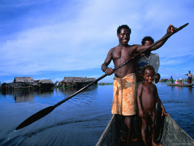 17799-6~Local-Sepik-River-Family-in-Dugout-Canoe-Madang-Papua-New-Guinea-Posters