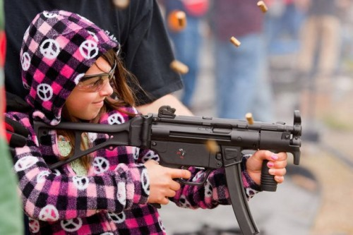 girl-shooting-a-machine-gun-634x423