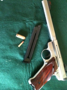 """Ruger Mark III with its standard 10-round  """"high capacity"""" magazine (.45 cartridge shown for comparison)"""