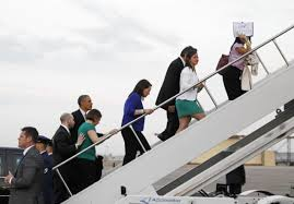 President Obama follows family members of children killed in the Sandy Hook Elementary School shooting, into Air Force One at Bradley Air