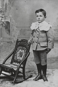 Hudson Cornelius Heinemann holds chair for his betters