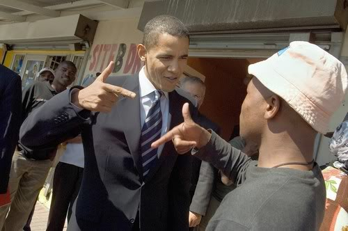 "Obama and Trayvon Martin Jr. trade  ""pistol"" gang signs"