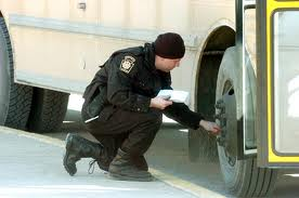 A cop who'll stoop to deflating  schol bus's tire will stop at nothing