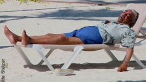 Charlie relaxes on taxpayer-paid-for beach