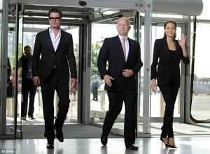 Statesmen in Black: Brad Pitt, British Secretary of State William Hague and Angelina  Jolie