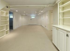 """Carpeting on the floor rates waste pipes above the door - the """"new addition"""" to 17 Highview."""