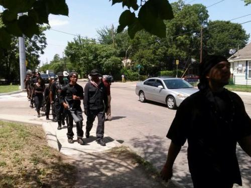 Micro-penised, lacking self-esteem, Huey P. Newton Gun Club members march in shame
