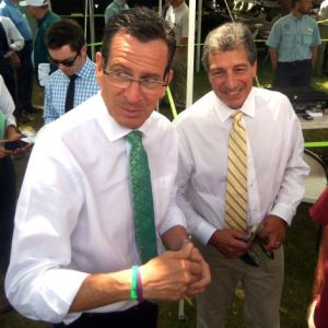 Dannel Malloy and pet agronomist feel the warmth