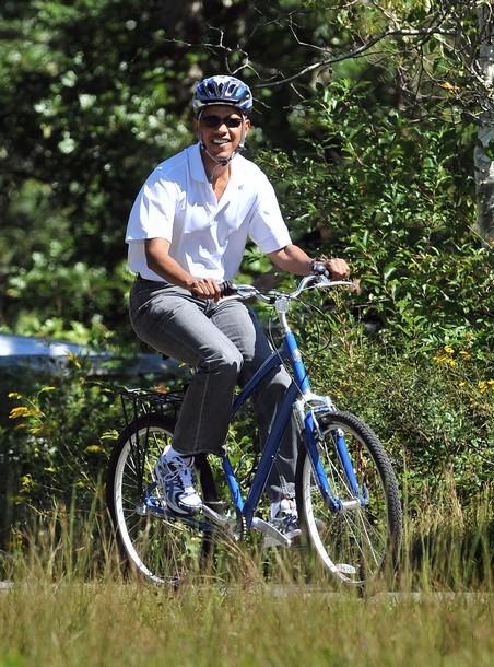 US President Barack Obama rides bicycle