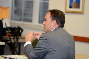 First Selectman Peter Tesei shows his muscle at a recent meeting in the Cone Room at Greenwich Town Hall.
