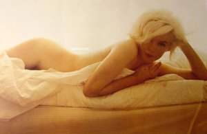 Marilyn Monroe prepares for bed: no objectional fat here