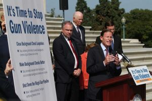 Flanked by his armed bodyguards, Dick Blumenthal demands that citizens be disarmed