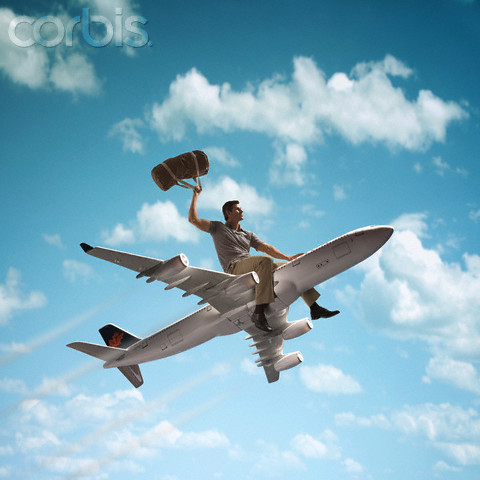 Man riding on top of a jet plane