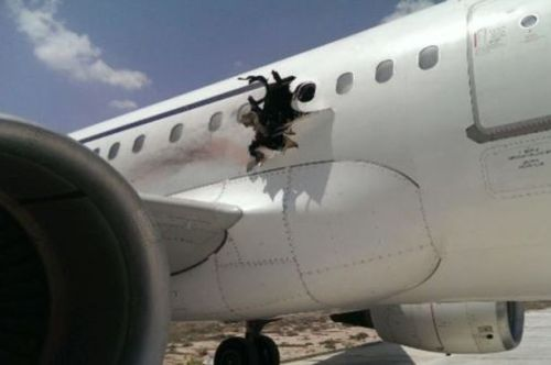 Dramatic-picture-shows-hole-in-side-of-passenger-plane-after-Daallo-Airlines-flight-caught-fire-moments-after-take-off