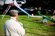 stock-photo-14040800-possible-pedophile-watches-a-children-s-playground-for-potential-prey